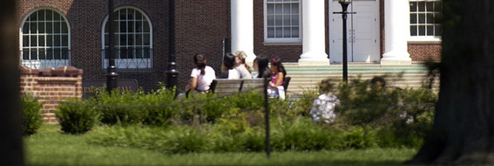 Students sit near the steps of Memorial Hall