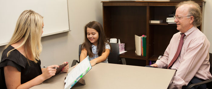 A student learns to give assessments to a young student