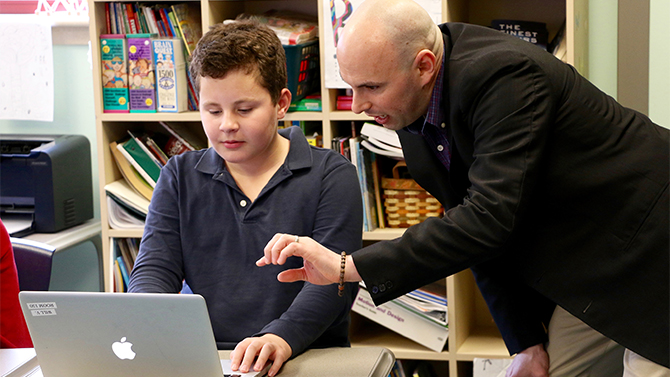 Josh Wilson works with a student at The College School.