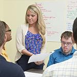 Student Lauren Hennessey in a CDS classroom
