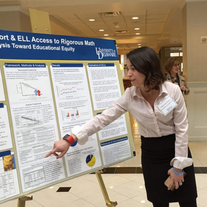 A graduate students presents her research.