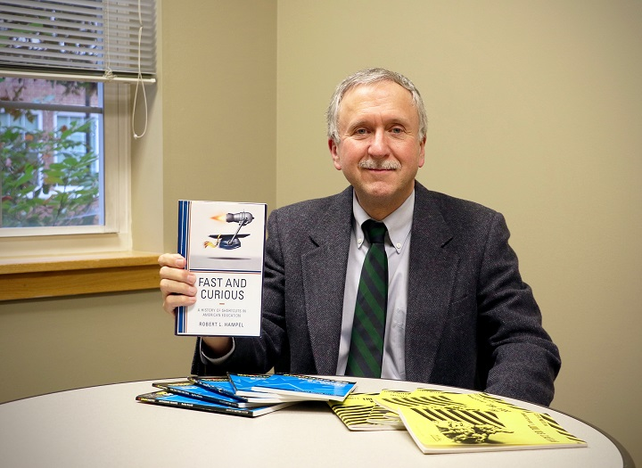 School of Education professor Robert Hampel displays his latest book Fast and Curious: A History of Shortcuts in American Education