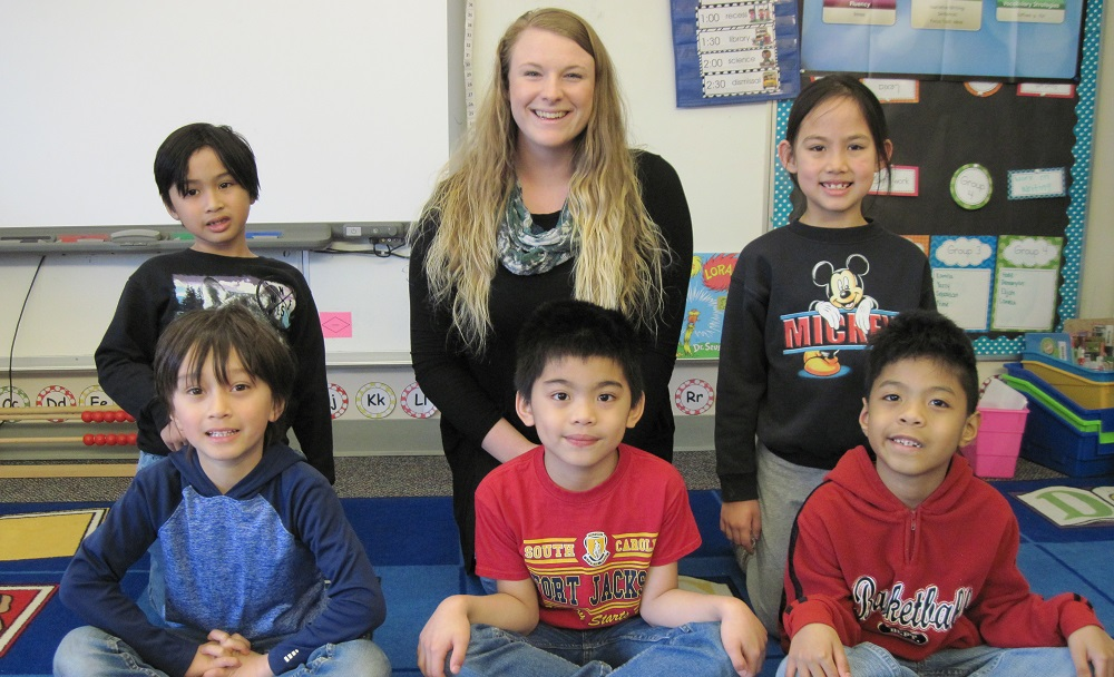 Elementary teacher education alumna Aubrey Bennett with students from her first-grade class in Unalaska, Alaska.