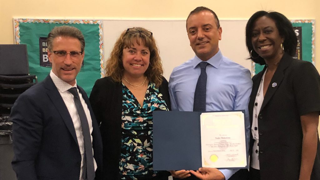 UD alumnus Nader Makarious is honored at the June 2018 Brandywine School District (BSD) board meeting. Pictured from left to right is Mark Holodick, superintendent of BSD, Michelle Kutch, supervisor of STEM, Science, and Social Studies at BSD, and Teri Quinn Gray, co-chair of the Delaware STEM Council.