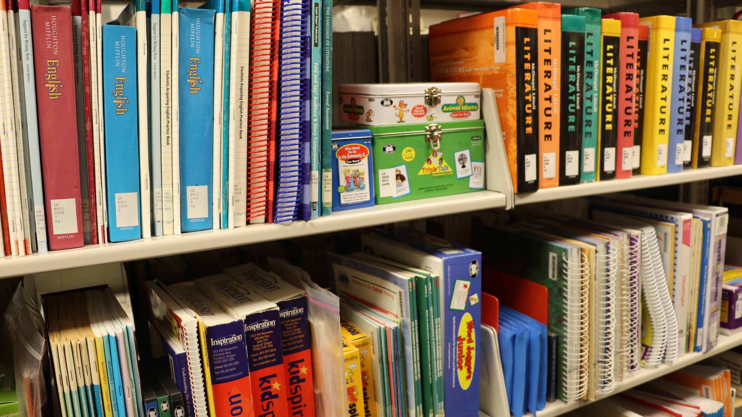 A row of books at the Educational Resource Center, including English and Literature guides.