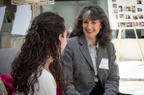 Laura Eisenman speaks with a student