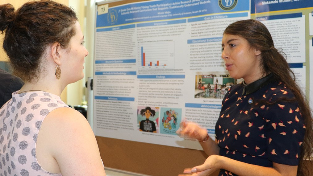 CEHD undergraduate student presents her summer research at a poster session.