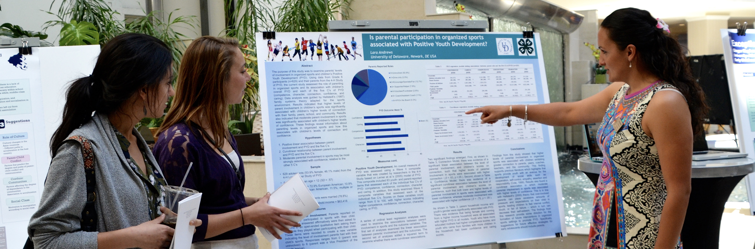 Student shows research poster at Steele Symposium