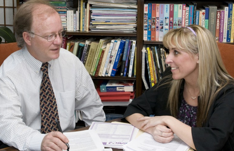 Doctoral student discusses research with professor