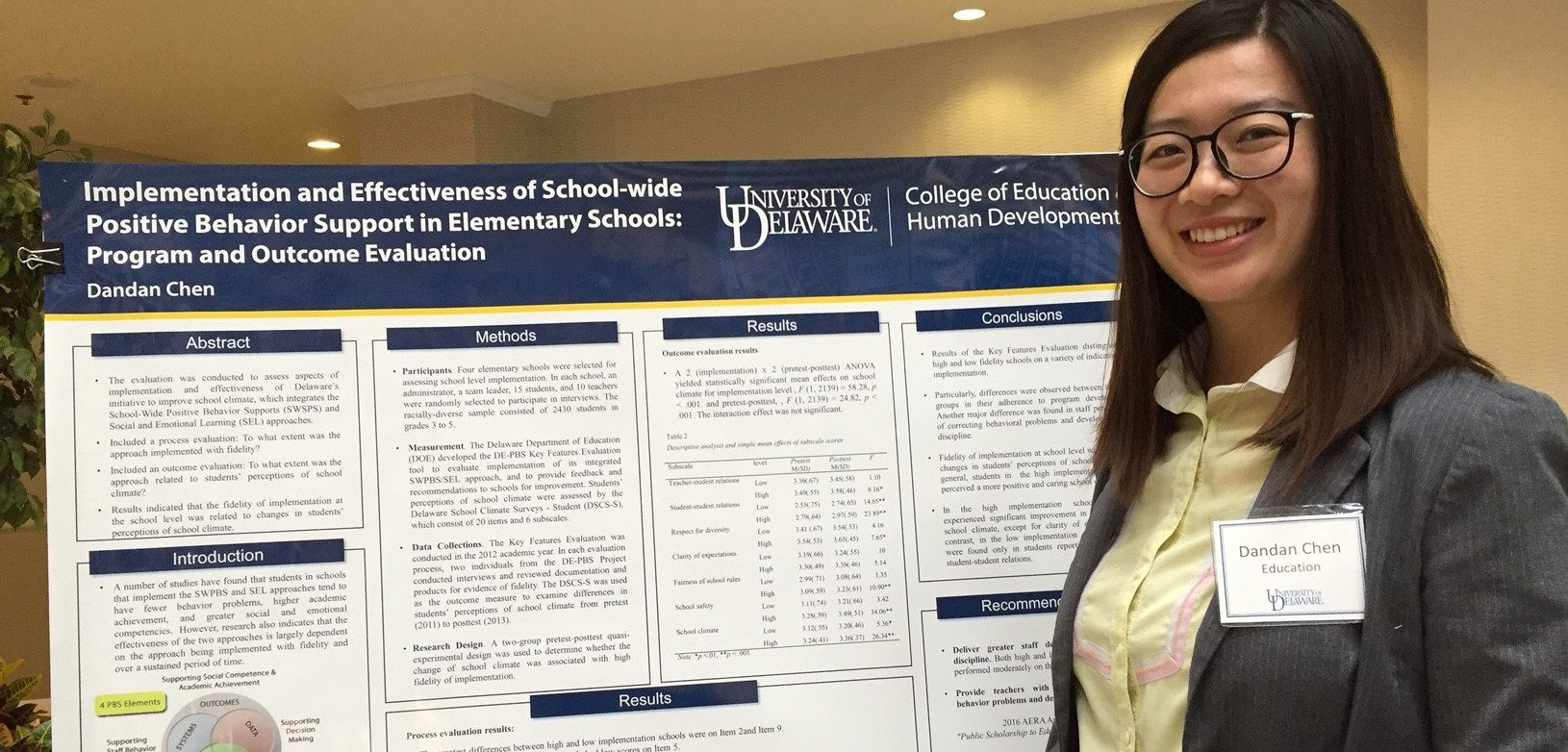 Doctoral student presents research in evaluation, measurement, and statistics with a poster at a college symposium.