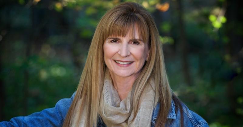 Head shot of Professor Nancy Jordan in an outdoor, wooded area.