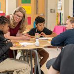 """University of Delaware School of Education Professor Amanda Jansen speaks with students at Milford Central Academy. Jansen recently published a new book called, """"Rough Draft Math: Revising to Learn."""""""